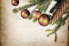 Fir branch and cone with balls, vintage filtered Royalty Free Stock Photos