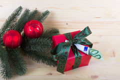 Fir branch with gift of money for Christmas Stock Photos
