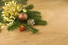 Fir branch with ornaments on woodgrain Stock Photo