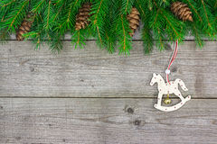 Fir branch with rocking horse Stock Photography