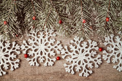 Fir branch and silver shiny snowflakes Stock Photo