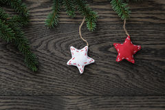 Fir branch with stars on oak table from above Stock Photography