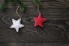 Fir branch with stars on oak table from above Stock Photos