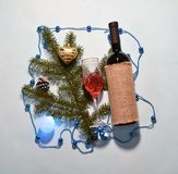 Fir branch and wine. Greeting card Royalty Free Stock Image