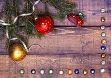 Fir branche with Christmas toys on wood background Stock Photos