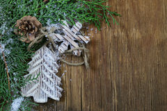 Fir branches arborvitae with  Christmas decorations. Fir branches arborvitae with wooden Christmas decorations Stock Photos
