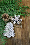 Fir branches arborvitae with  Christmas decorations. Fir branches arborvitae with wooden Christmas decorations Stock Images