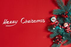 Fir branches border on red background, good for christmas backdrop. The inscription - Merry Christmas. Fir branches border on red background, good for christmas royalty free stock photography