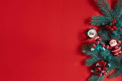 Fir branches border on red background, good for christmas backdrop. Top view. Flat lay. Copy space. Still life. Christmas and New year stock photo