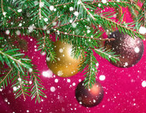 Fir branches with Christmas balls. Stylized falling snow Royalty Free Stock Photo