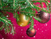 Fir branches with Christmas balls. Stylized falling snow Royalty Free Stock Images