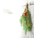 Fir branches with Christmas baubles hanging as a winter decorati Royalty Free Stock Image