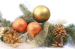 Fir branches and Christmas decorations Stock Photos