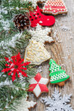 Fir branches and Christmas decorations and gingerbread. Royalty Free Stock Photo