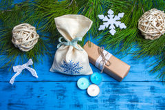 Fir branches, Christmas gifts and decorations on blue wooden background Royalty Free Stock Image
