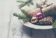 Fir branches and Christmas toys on the plate stock photos