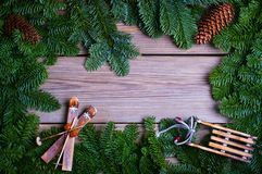 Fir branches with cone on wooden boards Royalty Free Stock Photos