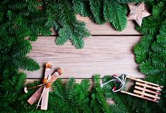 Fir branches with cone on wooden boards Stock Images
