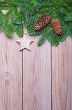 Fir branches with cones on wooden boards Royalty Free Stock Photo