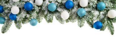 Fir branches decorated with cool colors Stock Photo