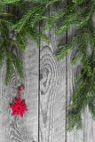 Fir branches and decoration red snowflake Royalty Free Stock Photo