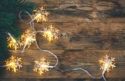 Fir branches, garland light snowflakes border Royalty Free Stock Photography