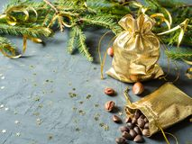 Fir branches on the grey concrete background with gold stars. New Year Christmas. Gold bag of nuts Royalty Free Stock Photos