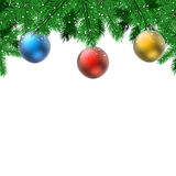 Fir branches with hanging decoration balls. Christmas card with white copy space Royalty Free Stock Image