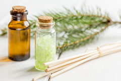 Fir branches and spruce bath salt and aroma oil on white table background Stock Image