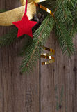 Fir branches and star on old  wooden background Stock Images