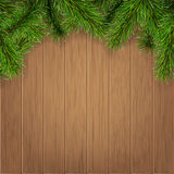 Fir branches on wooden boards. Background. Vector christmas card template Stock Image