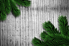 Fir branches on wooden planks. With copy space Royalty Free Stock Photography