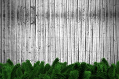 Fir branches on wooden planks. With copy space Stock Photography