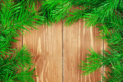 Fir branches on wooden table. Copyspace background Stock Photos