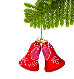 Fir and christmas red bells  on white Stock Images