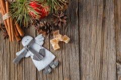Fir, cone and christmas ball on rustic table Stock Photos