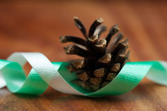 Fir cone and ribbon for christmas Stock Photography