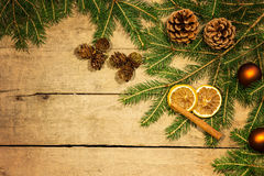 Fir cones and branches on wood Stock Photo
