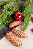 Fir cones, Christmas ball and Green fir branches Royalty Free Stock Photography