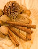 Fir cones, cinnamon and walnuts Royalty Free Stock Photos