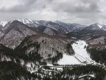 Winter scenery in Ciucas mountains, Romania, aerial view. Fir and coniferous forests of the Ciucas mountains in Romania, part of the middle Carpathian range , in Royalty Free Stock Image
