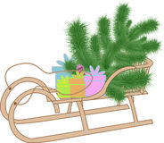 Fir and presents on a sled Royalty Free Stock Photo