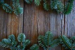 Fir real branch christmas symbol on wood stock photo