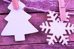 Fir tree ands snowflake toys on wooden background Stock Photo