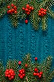 Fir tree as frame on knitted sweater background. Christmas concept. Abstract pattern. Flat lay. Stock Photos