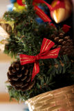 A  fir tree with bow and cones Stock Photography