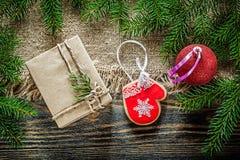 Fir tree branch bagging Christmas ball gingerbread present box o Royalty Free Stock Image