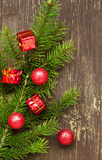 Fir Tree Branch with Balls and Gifts Stock Photography
