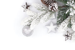 Fir tree branch with christmas decor covered with snow Royalty Free Stock Photography