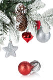 Fir tree branch with christmas decor covered with snow Stock Photo